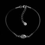 srebrna bransoletka na sznurku z ziarnem kawy
